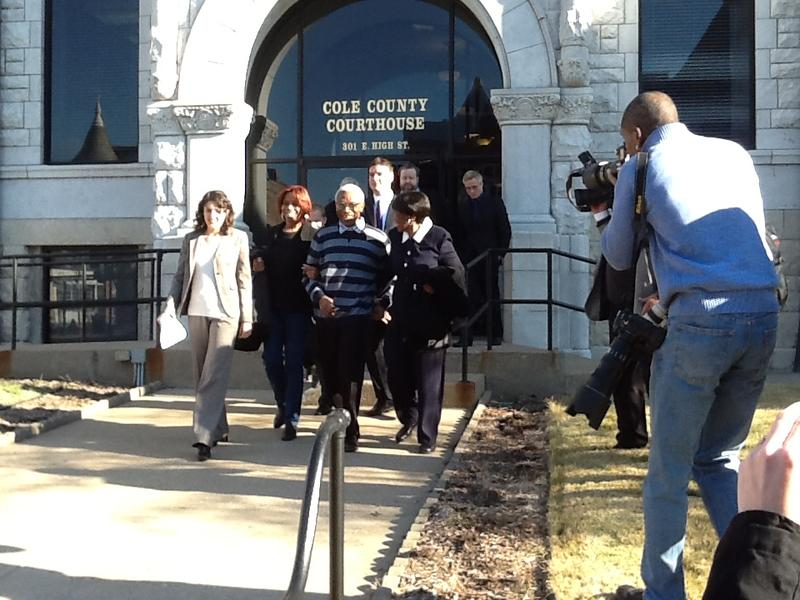 George Allen, center, leaves the Cole County Courthouse in Jefferson City on Nov. 14, 2012 after a judge threw out his 1983 murder conviction.