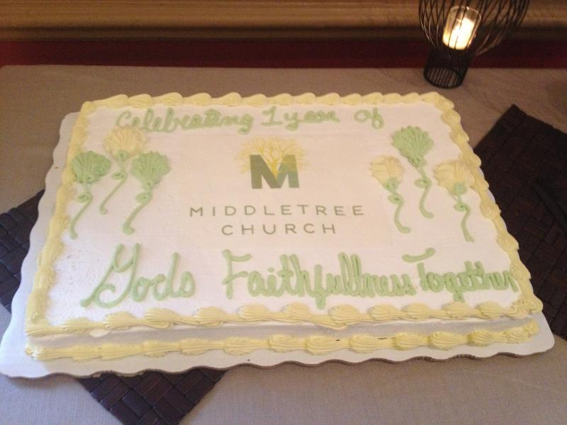 The church commemorated their first anniversary with cake after service.
