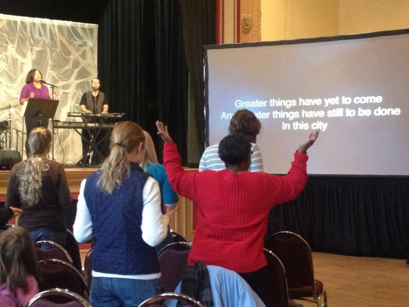 The congregation stands on its feet during praise and worship.