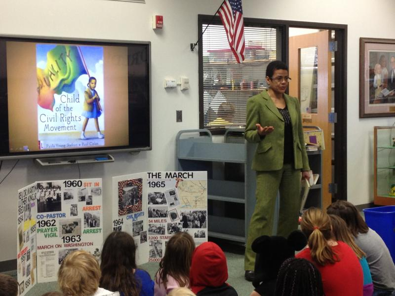 Shelton gives a reading of her book to students at Long Elementary.