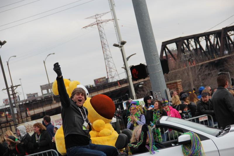Grand Marshal, Pulitzer Prize winning editorial cartoonist Mike Peters, throws out beads during the annual Soulard Mardi Gras Parade on Feb. 9, 2013.