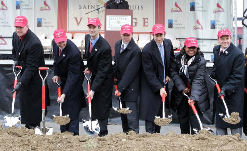 St. Louis Cardinals and other officials participate in the groundbreaking ceremony of Ballpark Village next to Busch Stadium in St. Louis on Feb. 8, 2013.