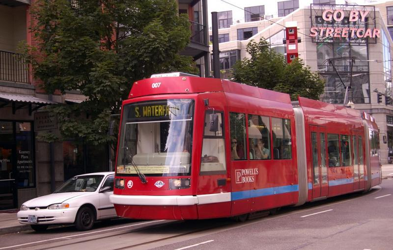 A modern streetcar in Portland, Ore.  Supporters of the streetcar plan say Portland is a working example of a city where economic development has been spurred by a streetcar line.