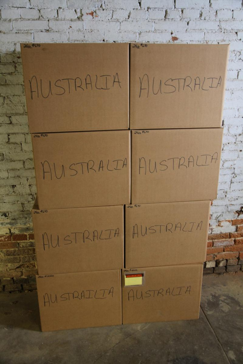 Boxes of pipes labeled for their eventual destination - Australia.