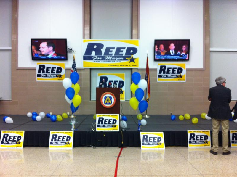 Slay's victory speech plays at Reed's watch party.