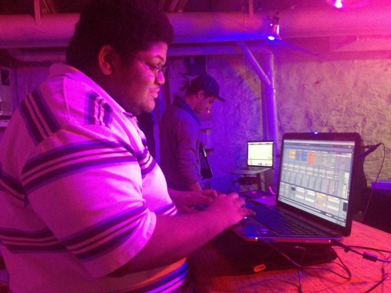 "Beatmaker Abnormal sets up his equipment for the inaugural ""Louder Than Words"" event, a monthly beat-based and instrumental music showcase."
