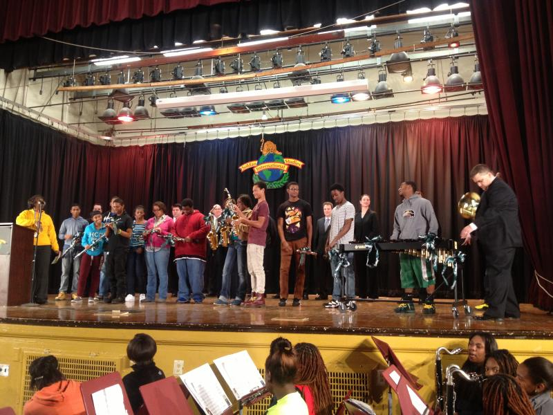 The students receive their new instruments from the Fidelity representatives. Over $22,000 in new instruments were donated to the Soldan International Studies High School band program
