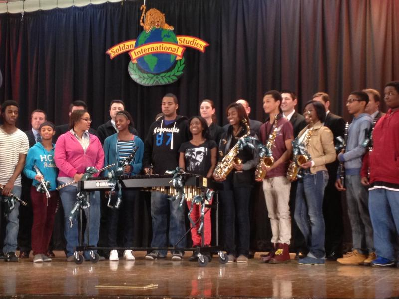 The students assemble after receiving their new instruments from the Fidelity representatives. Over $22,000 in new instruments were donated to the Soldan International Studies High School band program