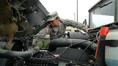 A Missouri National Guard member stages vehicles at the Cape Girardeau armory in preparation for possible use in state emergency duty.