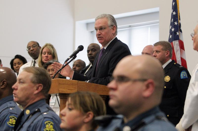 Flanked by law enforcement officials and health professionals, Missouri Governor Jay Nixon details a new plan on the impact of strengthening Medicaid on mental health, in St. Louis on March 3, 2013.