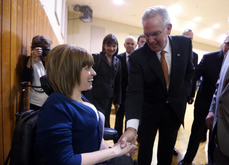 Mo. Gov. Jay Nixon (at right) speaks with Paraquad CEO Aimee Wehmeier in Kirkwood, Mo. on March 26, 2013. Nixon was in Kirkwood speaking to community leaders about expansion of Medicaid.