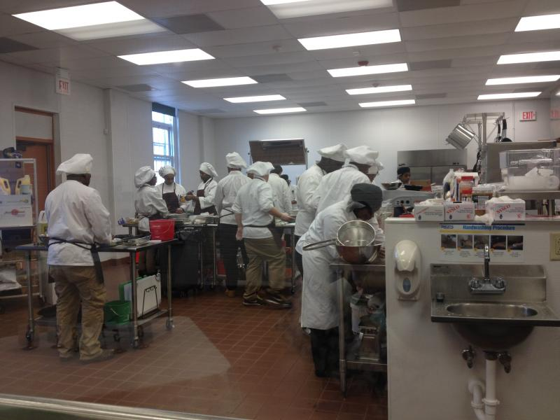 Students scramble in the kitchen to finish their dishes for the competition. The task was to create a healthy lunch of one entree and two sides.
