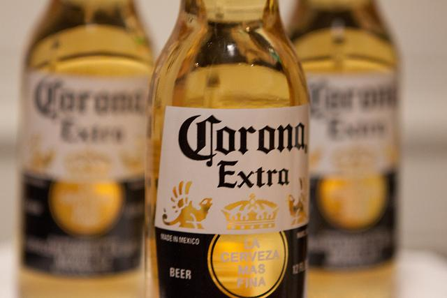 Anheuser-Busch InBev and the Department of Justice have reached a deal that will allow AB-InBev to buy the rest of Grupo Modelo, the maker of Corona.