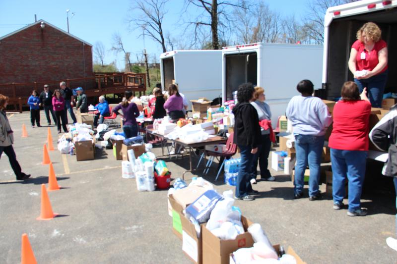 Faculty and Staff of the Hazelwood School District collect and distribute supplies to residents affected by severe weather, on Saturday, April 13.