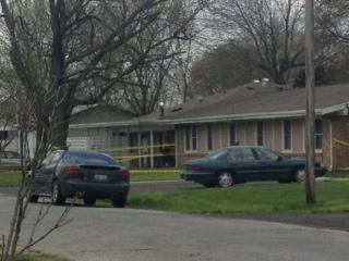Outside the scene in Manchester, Ill. where the slayings of five people are being investigated.