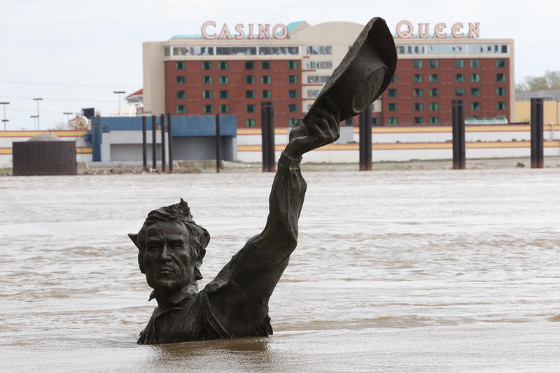The rising Mississippi River takes over the Lewis and Clark statue on the St. Louis Riverfront in St. Louis on April 19, 2013.