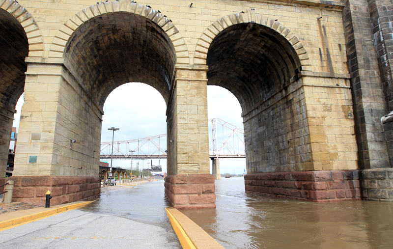 Water begins to cover roads underneath the Eads Bridge on the St. Louis Riverfront in St. Louis on April 19, 2013.