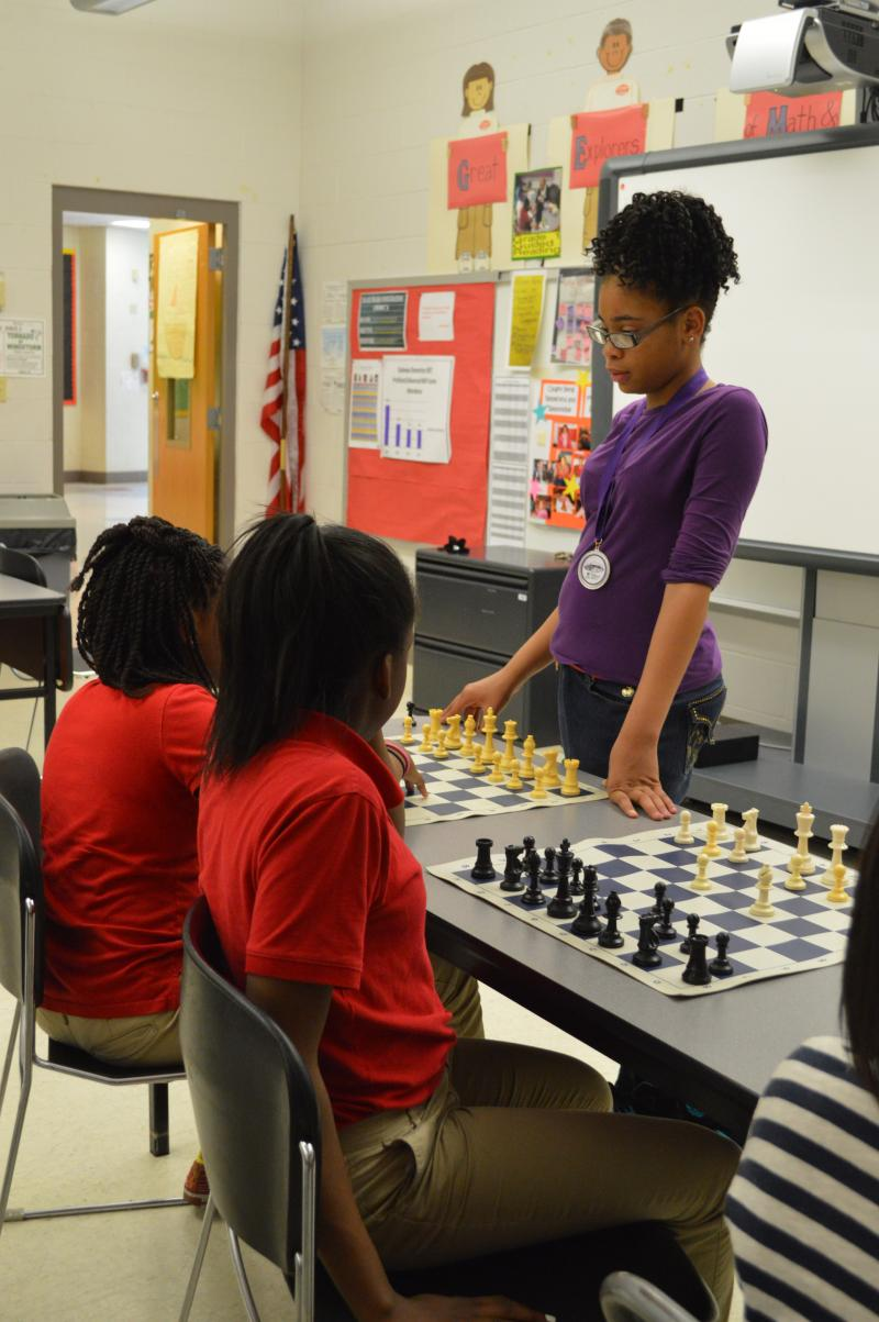 Shakoor plays against students who have stayed after school to receive chess instruction. The 12 year old recently surpassed 250 regular rated wins, a significant milestone as recogized by the US Chess Federation.