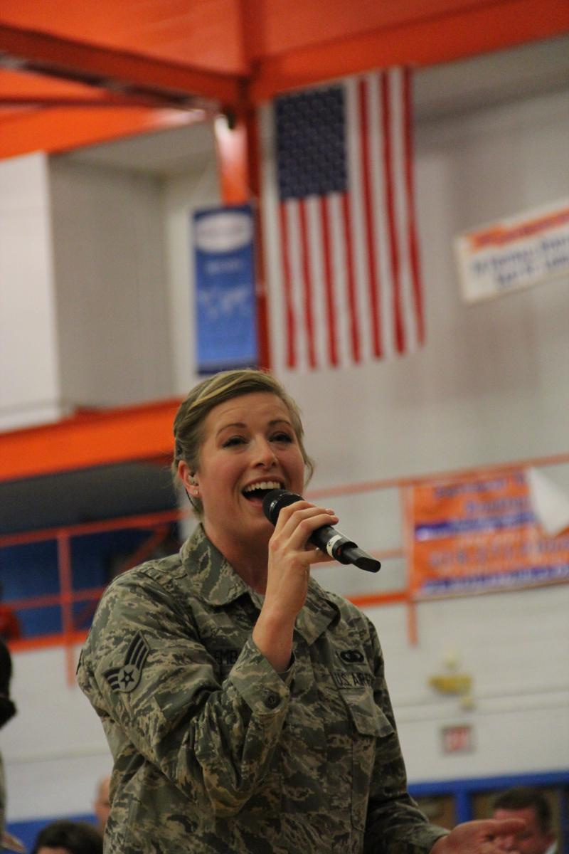 Senior Airman Carmen Emborski performs with the Air Force Band of Mid-America at East St. Louis High School.