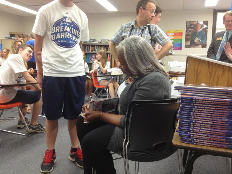 "Sharon Robinson signed books and spoke to students as part of the ""Breaking Barriers - In Sports, In Life"" program. She was there to congratulate essay contest winner Jennifer Wayland."