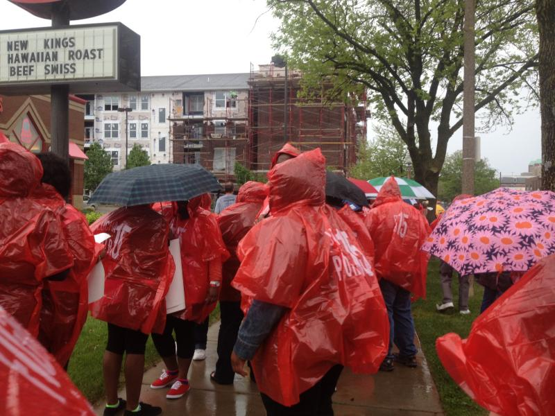 Ponchos were quickly distrubuted once the rain began to fall, and the chanting continued.