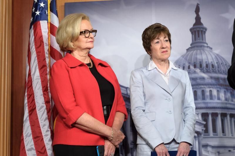 Senator Claire McCaskill next to Senator Susan Collins, a Republican co-sponsor of the bill.