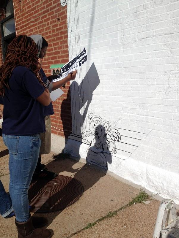 Students receive instruction from McCammond , who  partnered with the Herbert Hoover Boys and Girls Club to creat the mural in The Grove.