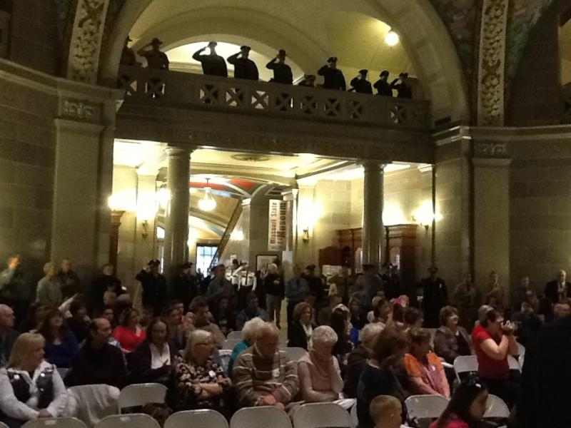Officials, members of law enforcement and families gather in the Missouri State Capitol rotunda to honor officers who have died in the line of duty on Saturday, May 4, 2013.
