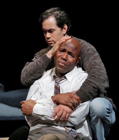 (Front to back) Arthur Woodley as Emile Griffith and Brian Arreola as Luis Rodrigo Griffith in Opera Theatre of Saint Louis' 2013 world premiere production of Champion.
