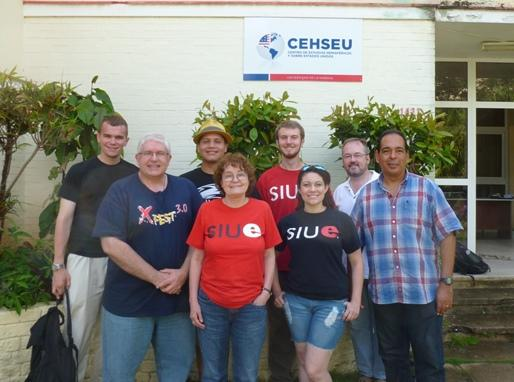 The SIUE group stands at the Centro de Estudios Hemisféricos y sobre Estados Unidos (CEHSEU) of the University of Havana.