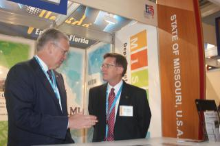 Mo. Gov. Jay Nixon (D) and acting Econ. Dev. Dir. Mike Downing, at the Mo. Pavilion located at the International Paris Air Show.