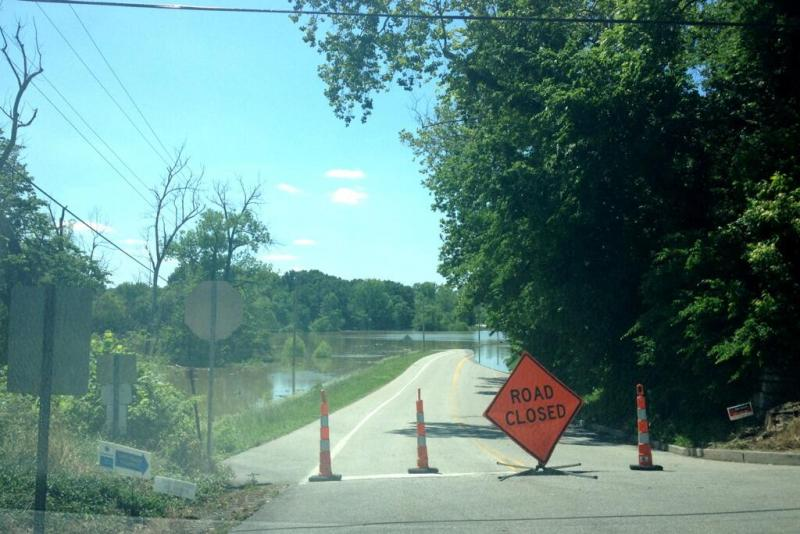 Highway K leading into Kimmswick, Mo., is almost completely underwater - a familiar sight up and down the Mississippi River.