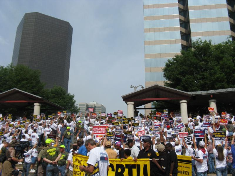 UMWA members and supporters hold up signs and face Peabody Energy in downtown St. Louis on June 17, 2013.