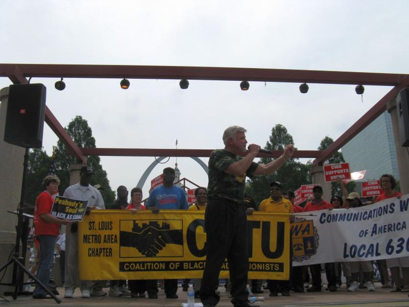Flanked by representatives from other unions, United Mine Workers of America President Cecil Roberts speaks to the crowd at a rally in downtown St. Louis on June 17, 2013.