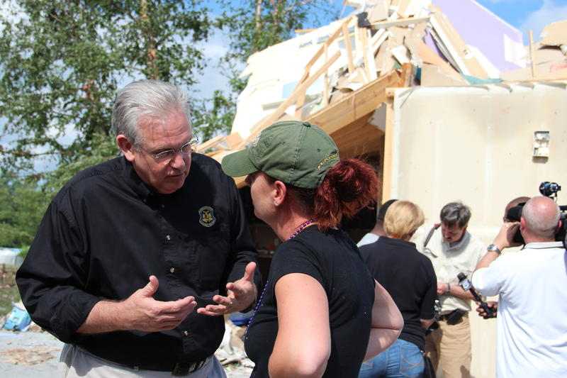 Mo. Gov. Jay Nixon speaks with residents while touring a storm damaged neighborhood in south St. Charles County.