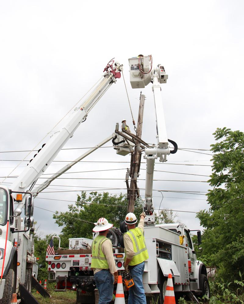 An Ameren Missouri Crew works to remove a downed power pole.