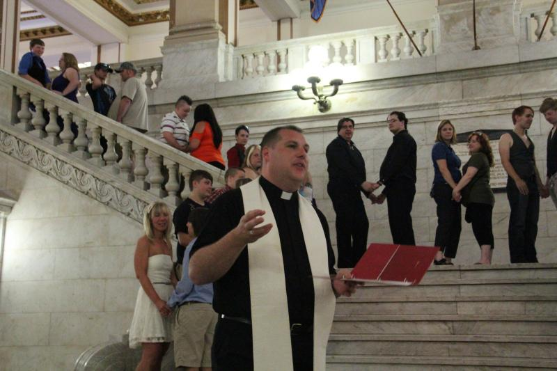 Family and friends erupted in applause during a mass commitment ceremony for same sex couples on Saturday, June 29.
