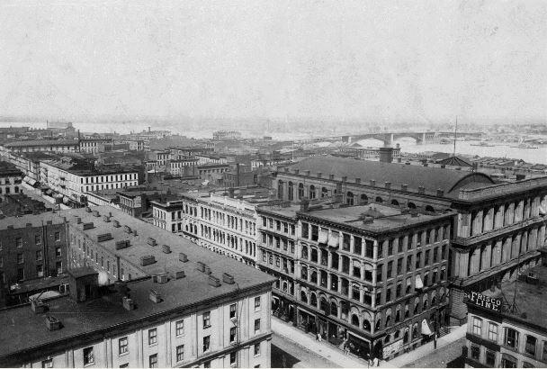 The St. Louis riverfront, looking northeast from the Old Courthouse in 1895.  This area now contains the Gateway Arch.  The buildings shown here were prized by many historic preservationists, who objected to the demolition of unique cast-iron structures.