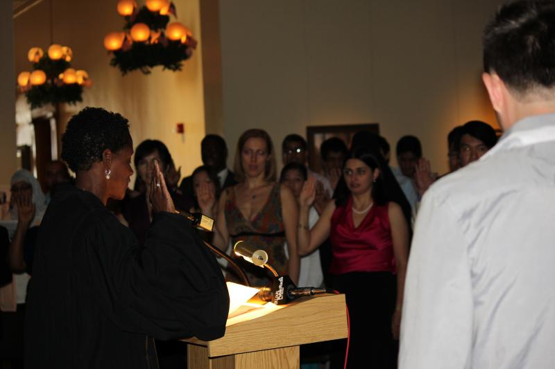United States magistrate judge Nannette A. Baker leads new citizens in the oath of citizenship on July 3, 2012, in the Old Courthouse in downtown St. Louis.