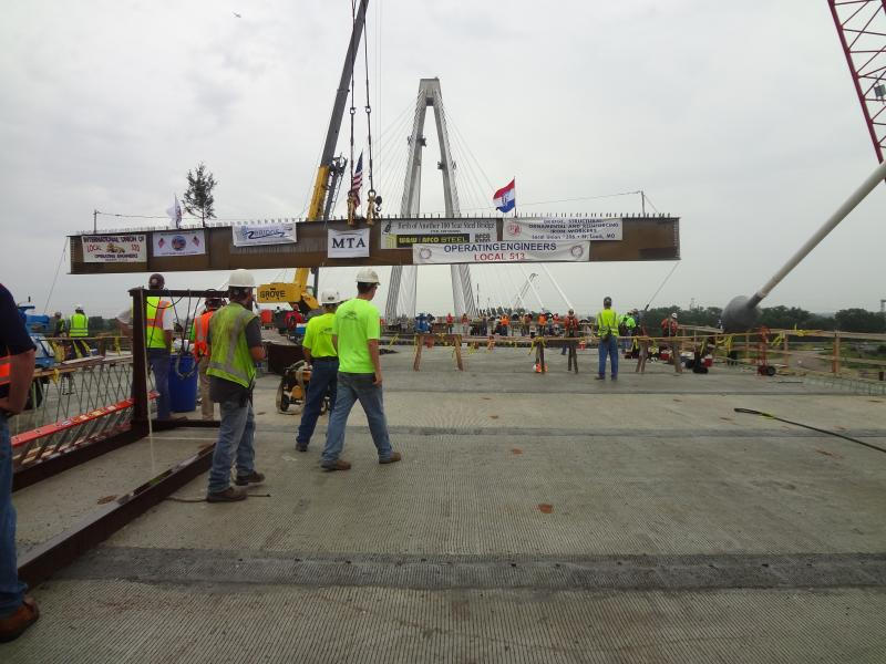 The beam is lifted to join the rest of the bridge.