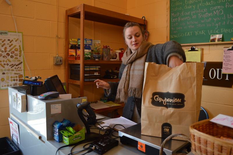 Former store manager Jill Whitman unloads stock from Companion Bakery. Customers can place weekly orders through the store and pick them up at the co-op.