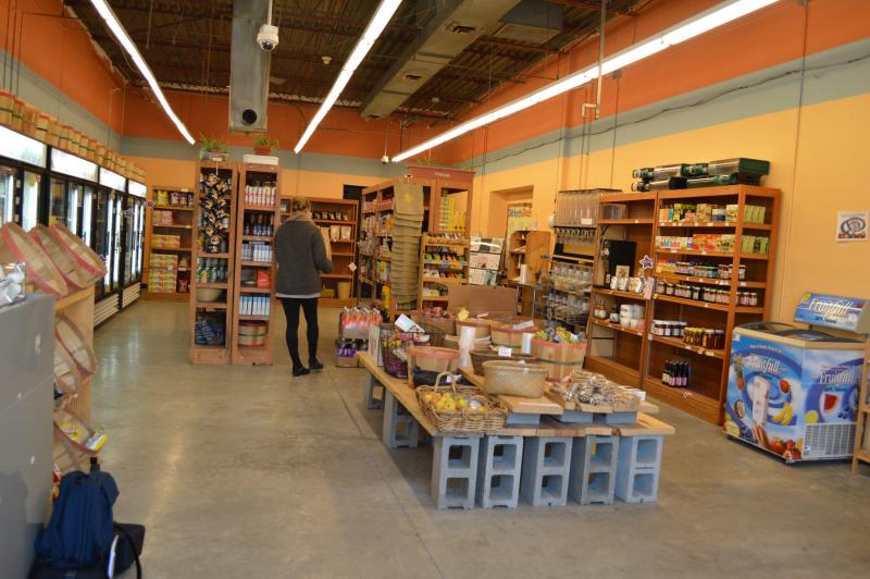 Interior of the Old North Food Co-op, with former store manager Jill Whitman in the background.