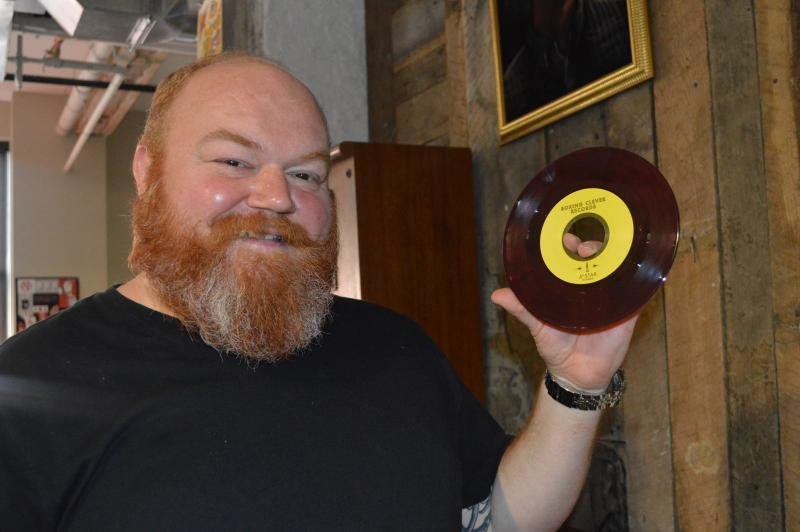 Creative director and head of business development Jim Harper shows off one of the 45's from the label.