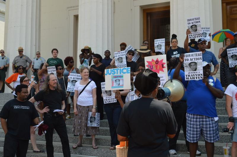 Megaphone in hand, Jamala Rogers encouraged protestors to turn their outrage into action at a rally in opposition of the not guilty verdict from the Trayvon Martin case.