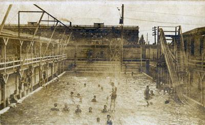 Outdoor swimming pool at the corner of Delmar and Melville, circa 1905-1908. In the background is the Park Hotel, now part of Washington University off-campus housing.