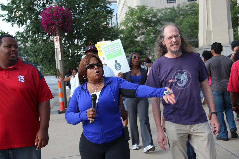 Democratic Mo. State Sen. Jamilah Nasheed (left) and John Chasnoff, program director at ACLU, Eastern Mo., lead a rally on Sunday, July 14.