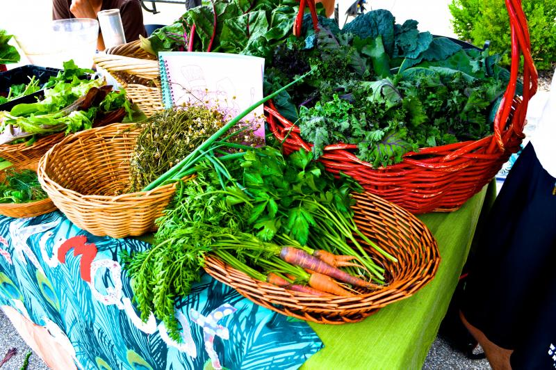 Fresh greens are available for purchase at the Market, as well as bread, sweets, and other items.
