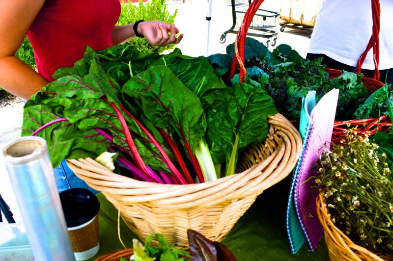 Fresh greens are available for purchase at the Market, as well as bread, sweets, and other items. The Market is across the street from Crown Candy Kitchen in Old North.
