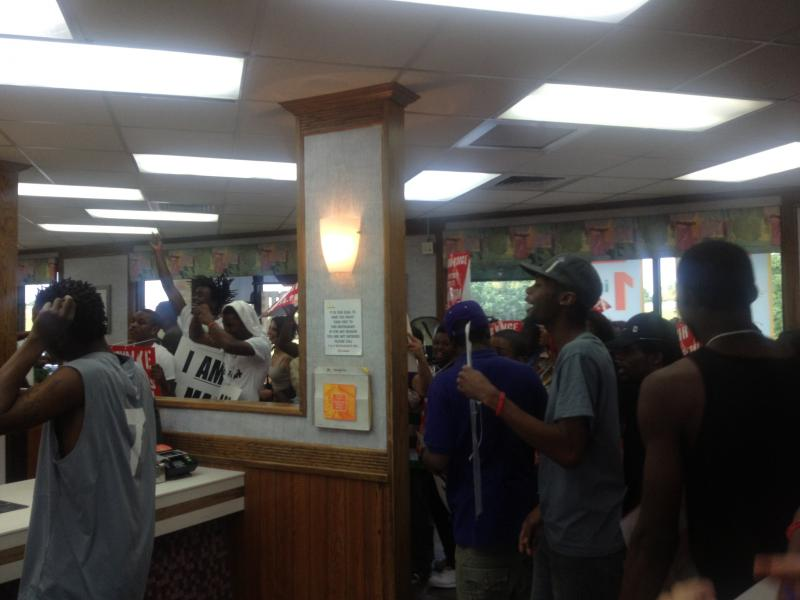 Protestors chanted and carried signs inside the McDonald's on South Broadway and urged employees to walk out with them.