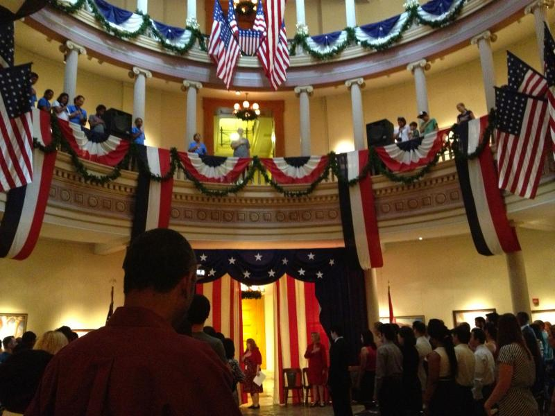 A naturalization ceremony is held in the Old Courthouse in downtown St. Louis on July 3, 2012.